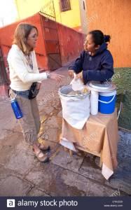 Source-_Alamy stock_north-america-mexico-guanajuato-state-guanajuato-woman-buying-hot-CYKCD0